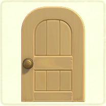ベージュの木組みのドア