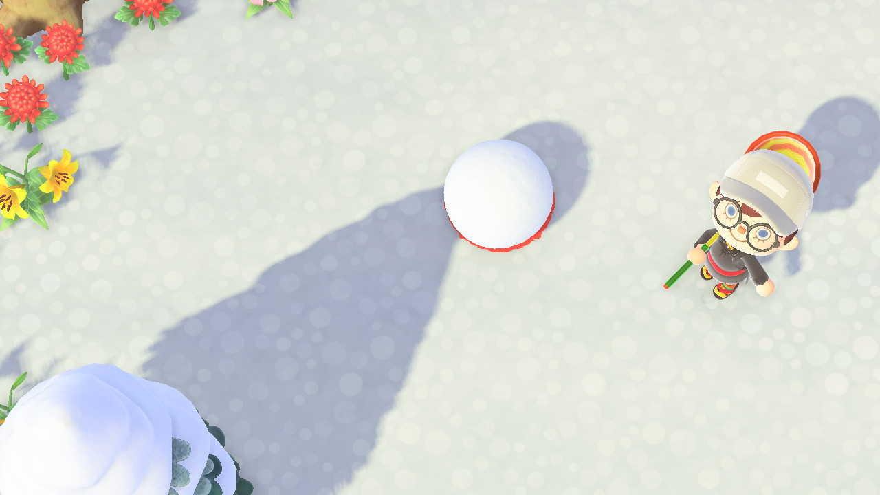 雪玉を蹴る