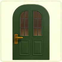 緑の縦長窓のドア