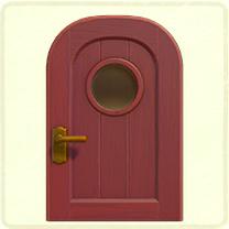 紫の丸窓のドア