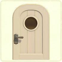 白い丸窓のドア