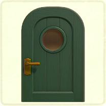 緑の丸窓のドア